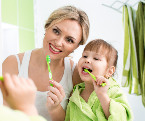 mother-and-daughter-brushing-teeth