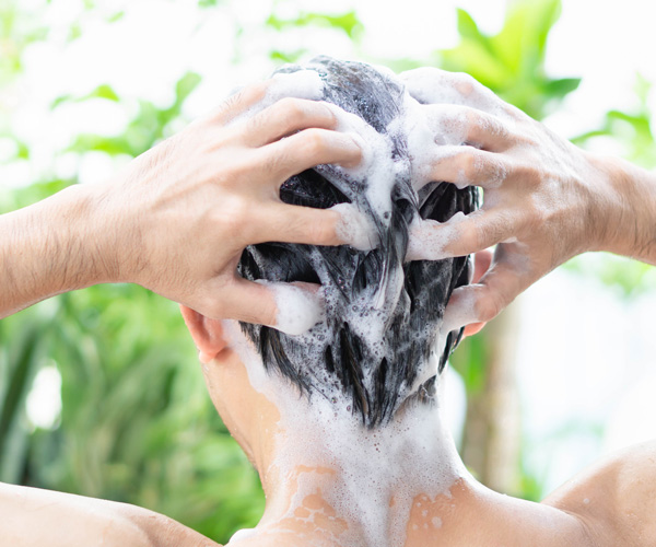 young-man-washing-hair-with-softened-water